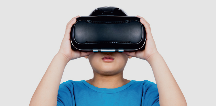 child wearing VR headset in blue shirt